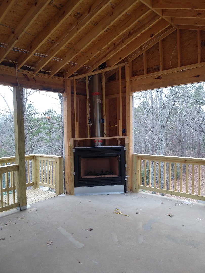 Installing outdoor fireplace on Deck