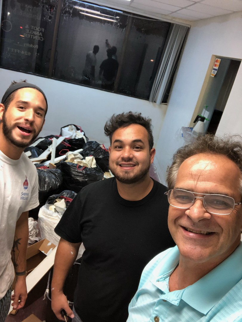 Palm Beach Gardens, FL - The Captain Painter in the city of Palm Beach florida with an exceptional painting crew performing a wallpaper removal applying prime and paint nothing less than Foot & Ankle Specialist Clinic