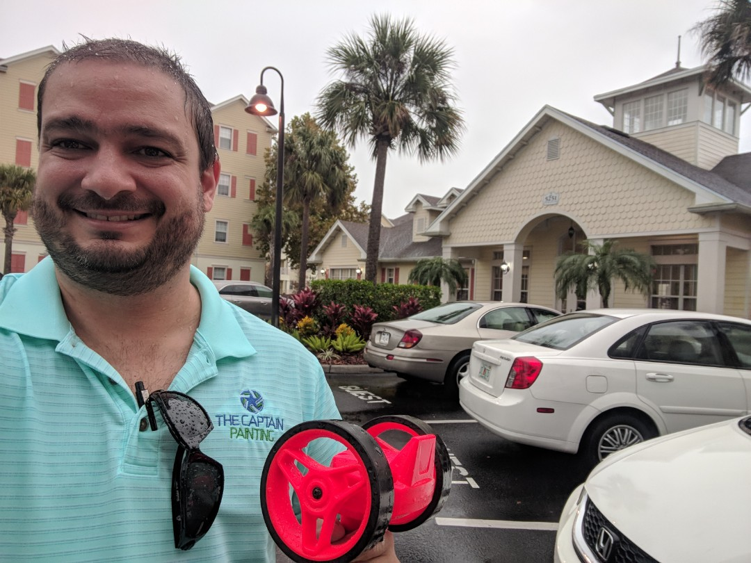 Kissimmee, FL - The Captain Painter is at Kissimmee , Florida doing and commercial painting and waterproof analysis report for a multi-family community under the rain!!!! Nothing stops the Captains....