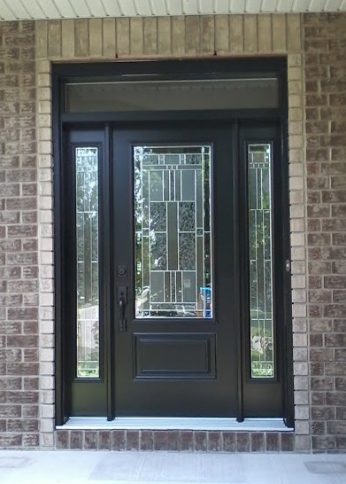 "Goulbourn, ON - Fantastically designed Black Portatec entry door with Cachet glass insert and matching sidelights! Complete with ball bearing hinges and 12"" security bar."