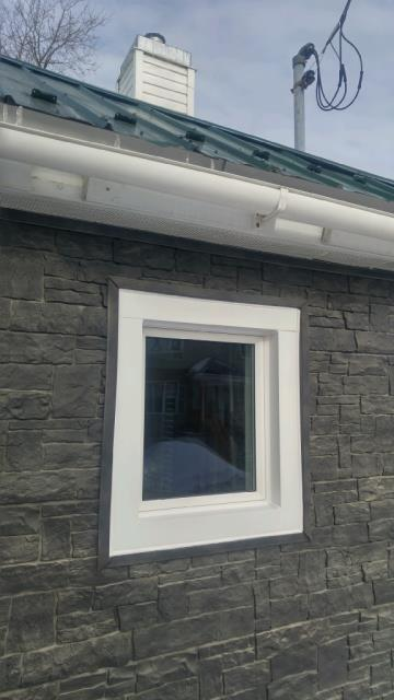 Vanier, ON - Our client was delighted to see the back of his old windows which were drafty in the winter and boiling in the summer! The 366 LoE coating and foam filled frames of his new windows will overcome both of those problems.