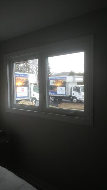Nepean, ON - Installing high efficiency vinyl windows to improve this client's energy efficiency.