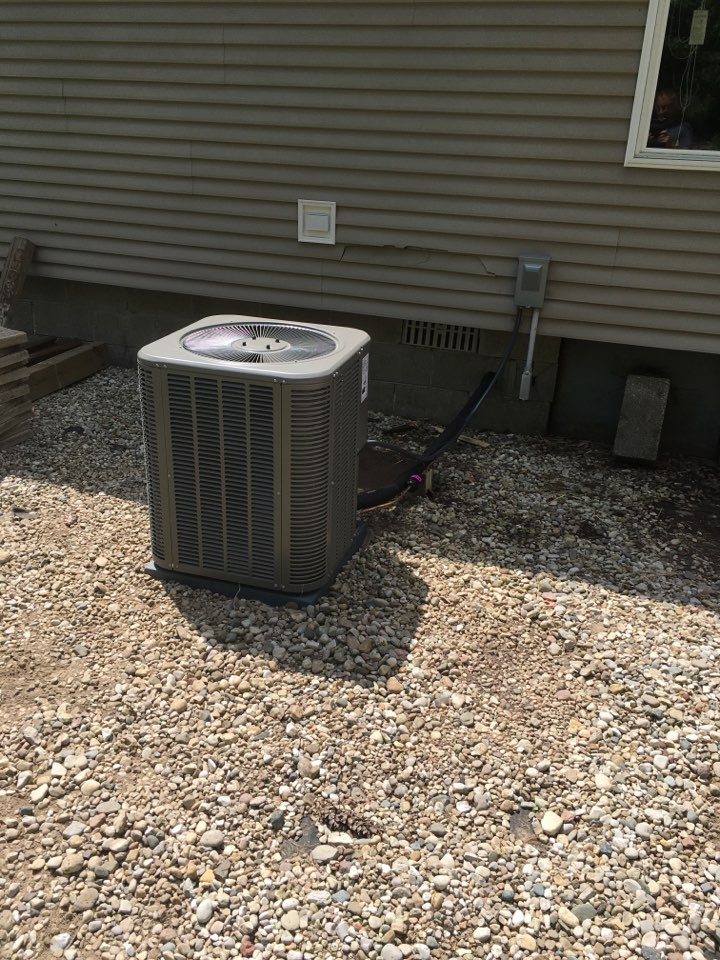 Stanwood, MI - New air conditioning condenser installed.