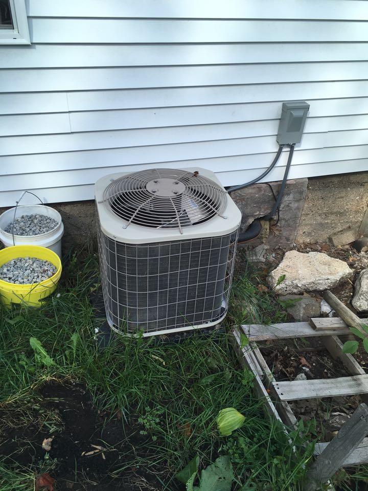 Belding, MI - Air conditioning freezing up.