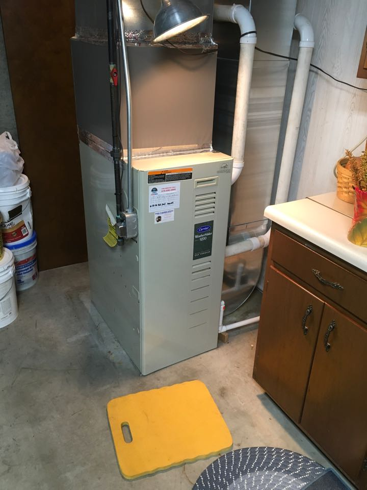 Belding, MI - Annual heating maintenance on Carrier furnace.