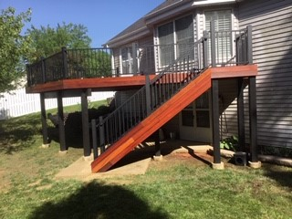 Ballwin, MO - Beautiful new Tigerwood deck, freshly oiled.  Tigerwood is a resilient and exotic hardwood that is well known for it's stunningly bold grain.  The black handrails help show off the rich color grain in the deck.  Ballwin, MO