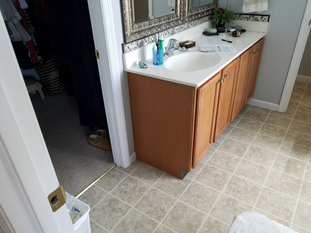 St. Peters, MO - Bathroom remodel all new fixtures tile floor onyx walls and vanity top of onyx white vanitian bowl