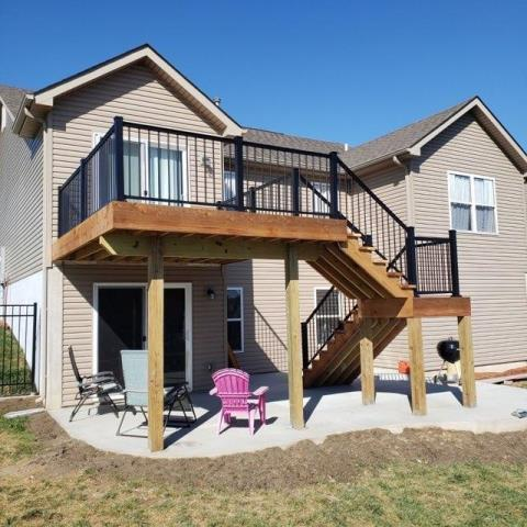 Gray Summit, MO - check out this gorgeous cedar deck with black aluminum handrails we just completed.  Expanded their living space even more by pouring a concrete patio underneath!