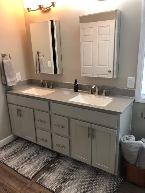 Wentzville, MO - Modern new bathroom.  Grey and white color scheme.  Onyx tops