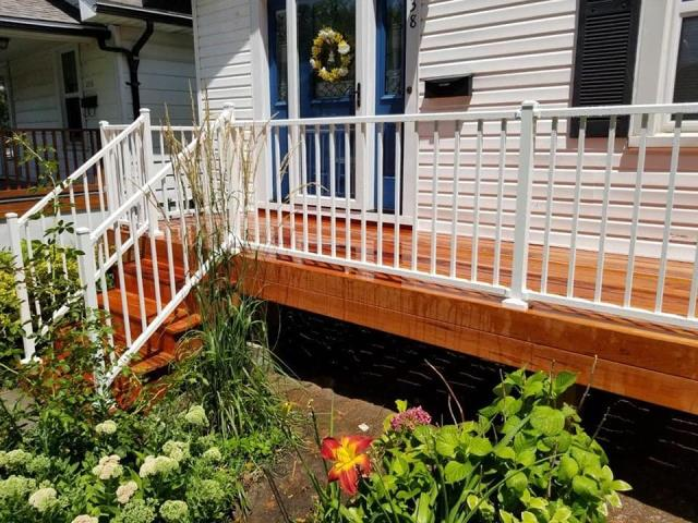 St. Louis, MO - Tigerwood deck with white aluminum handrails to match the house.  Clean finish