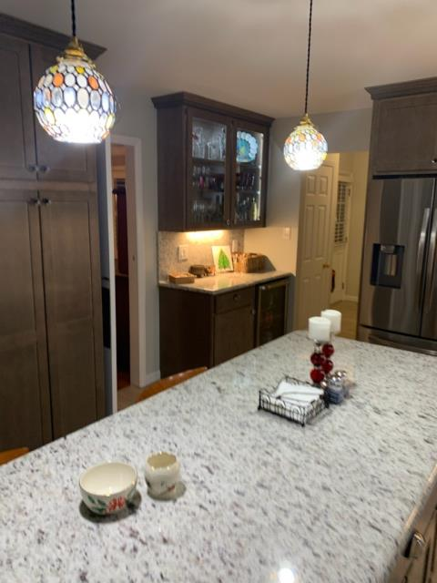 Chesterfield, MO - New kitchen update - new pendant lighting, gorgeous new granite countertops, beautiful new cabinets, some with glass fronts.