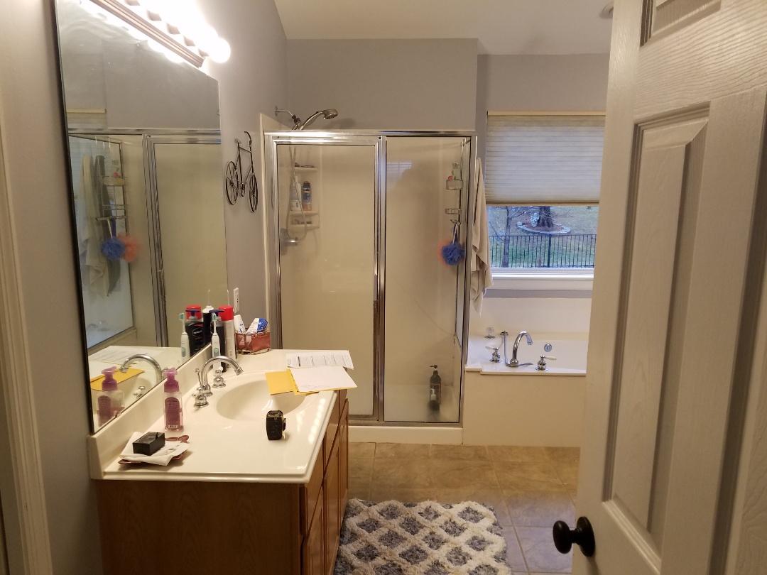 Saint Charles, MO - Bathroom remodel, Onyx show base tile walls . Drop in soaking tub. New LVT floor . All new ORB plumbing fixtures