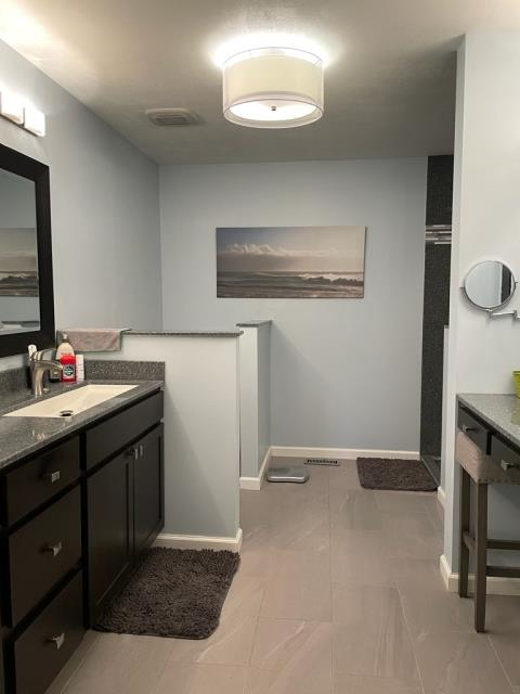 Ballwin, MO - another view of this beautiful new updated bath - onyx vanity, tile floor, new make up area.  So fresh!