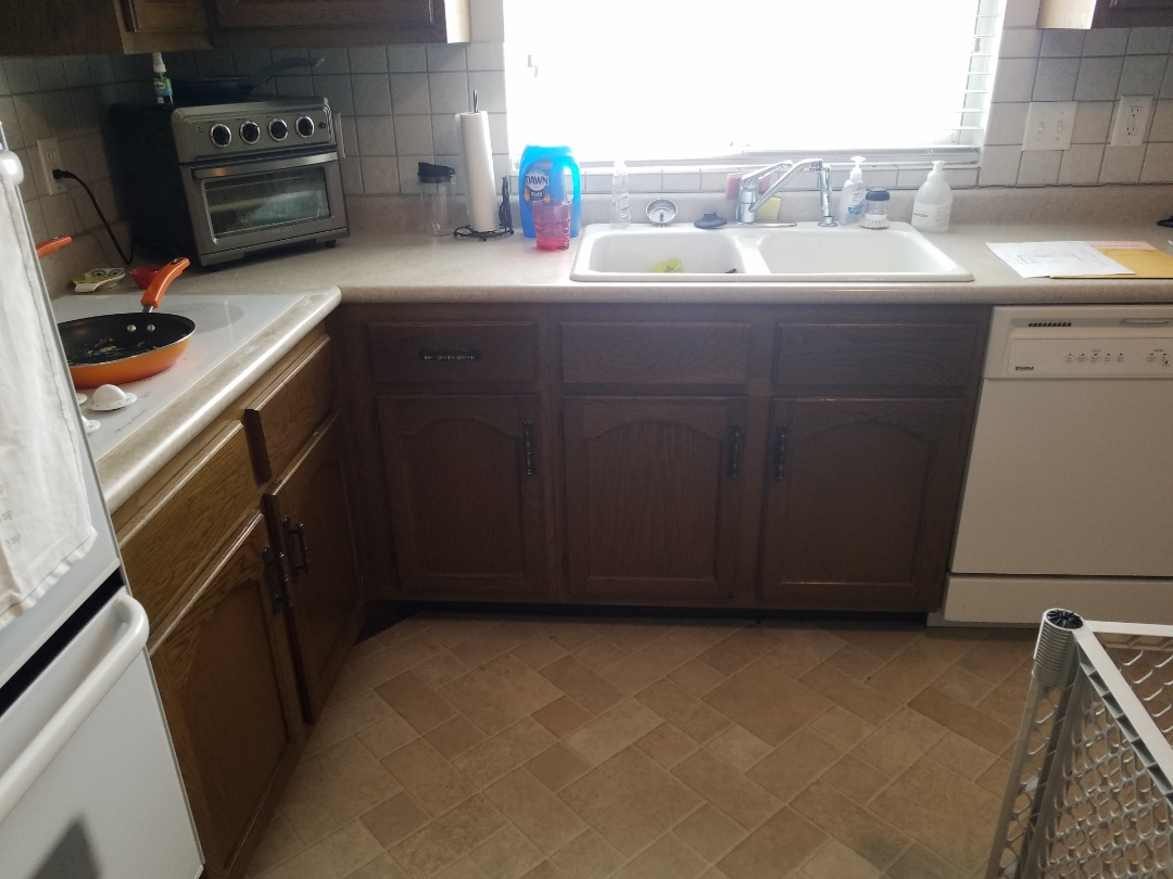 Florissant, MO - Kitchen, painting cabinets,  new island with overhang for seating . Granite countertops. New low profile micro wave and fridge