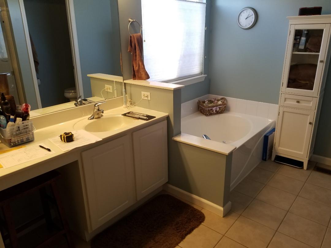 Saint Charles, MO - Bathroom remodel Onyx shower base and walls,  frameless pivot shower doors. New vanity with granitebtos .all new brush Nickle fixtures