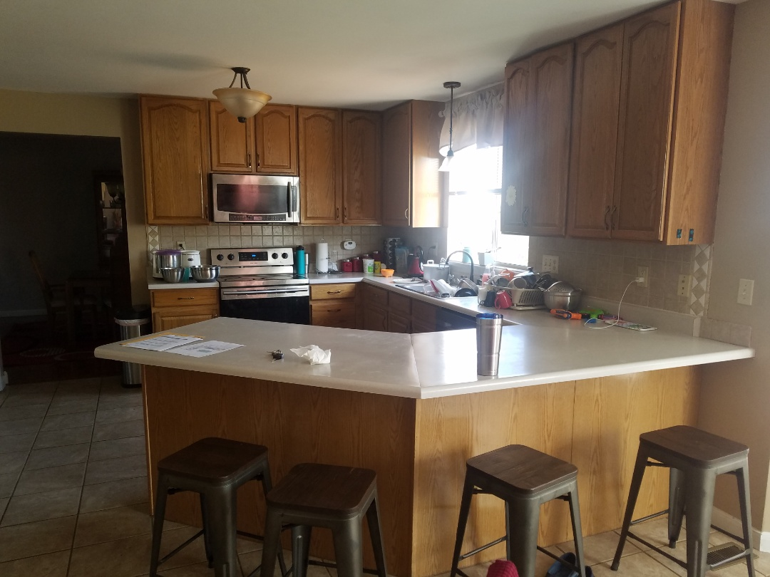 O'Fallon, MO - Starting a complete kitchen gut and remodel. Working to add 39 inch cans with crown granite countertops and new LVT flooring.