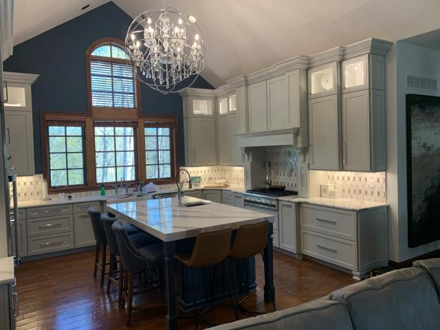 Wildwood, MO - Elegant new kitchen with Omega cabinets, quartz countertops, two toned color scheme, which is a hot design trend right now and creates visual interest!  Check out that gorgeous backsplash and the under cabinet lighting.