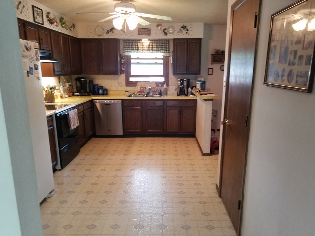 Saint Charles, MO - Going to have another happy home owner . Finally getting her  kitchen remodeled.  42 inch cabinets to the cieling. Quartz countertops. All new Appliances. Finally getting her microwave over her range . And to top it off new LVT flooring.