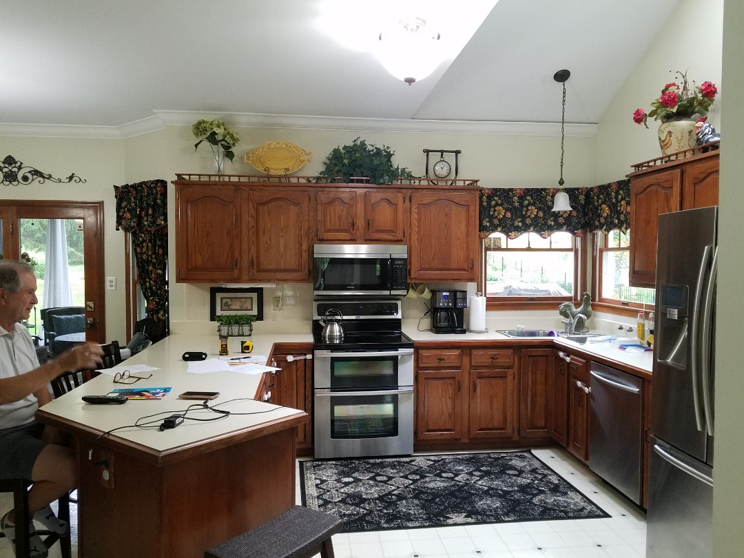 Saint Charles, MO - Another customer who has been looking forward to a kitchen remodel for 25 years  42 inch cabinets with crown molding. And light rail .Quartz counertops.new island .LVT flooring. Pendant lights over the island