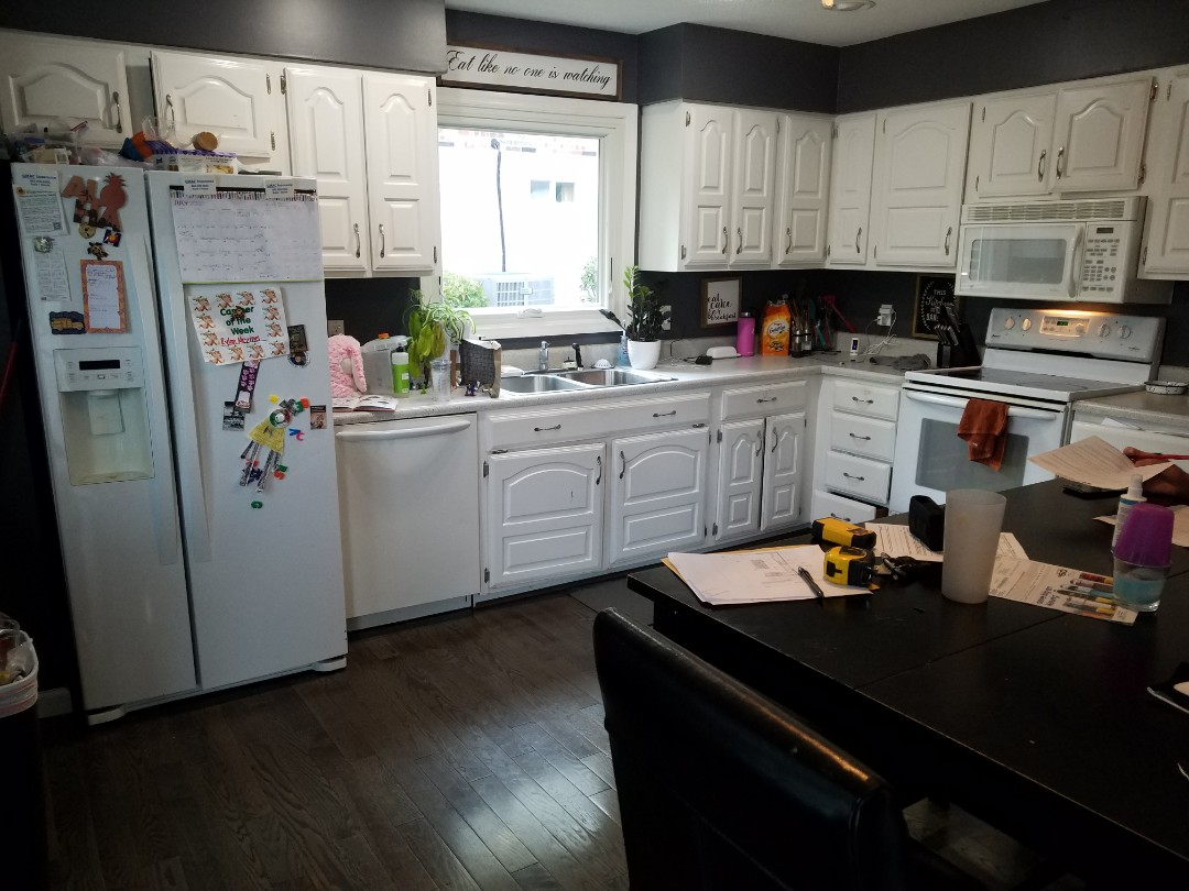 Bridgeton, MO - Kitchen remodel granite countertops island with pendants above . All new Appliances. Cabinets to the cieling with crown molding. Microwave drawer in the island