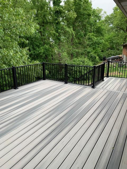 Chesterfield, MO - This homeowner chose Duralife decking.  So beautiful and rich in color and variation.  This material features CoolTrac which is engineered to stay much cooler than other composite boards.  Averages to stay over 18% cooler than traditional composite decking!!!  Love the Westbury aluminum railing.
