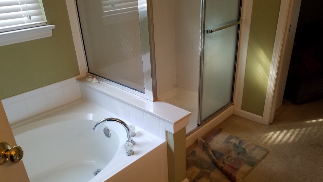O'Fallon, MO - Existing Bathroom remodeling installing Onyx double curb shower base tile walls. Free standing tub floor mount faucet. New LVT floor bathroom and walk in closet . Double bowl vanity, quartz countertop