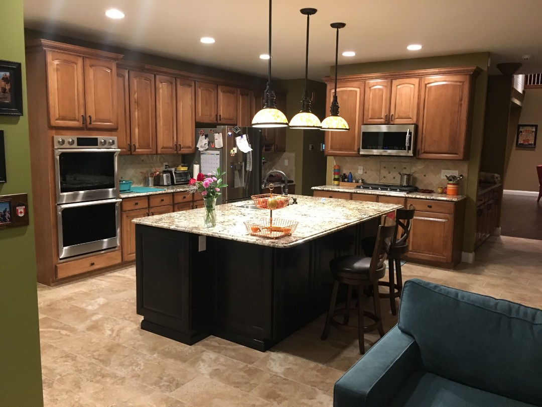 Maryland Heights, MO - Wanting to update her cabinets.  Loves her pendant lighting and island