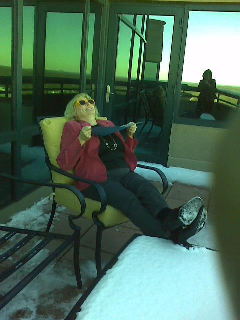Fairfax, VA - Client Julie with MMCG Law is catching some chilly rays on our snowy balcony! Awesome Office Space in FAIRFAX.