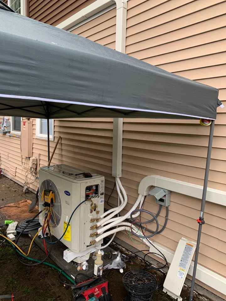 Tacoma, WA - Come rain or shine. Another Carrier ductless heat pump installation for tacoma power.