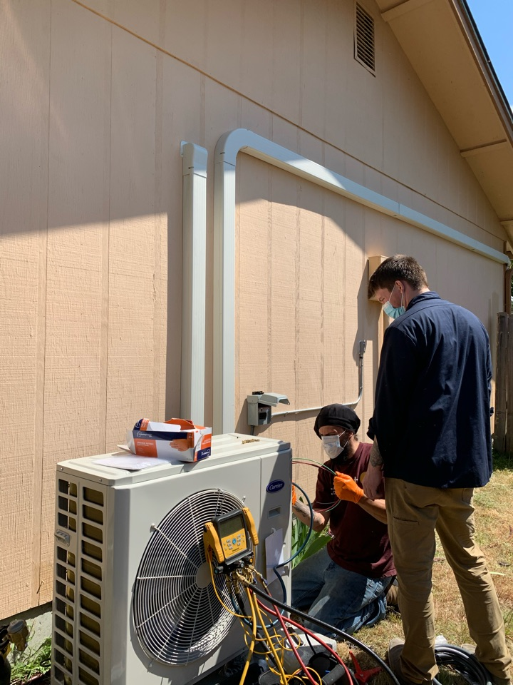 Tacoma, WA - Another Tacoma Power ductless heat pump installation. Finishing up the final connections on a Carrier Infinity ductless heat pump system.