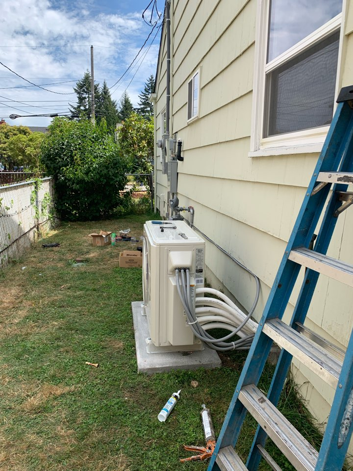 Tacoma, WA - Finishing new carrier ductless heat pump installation with a new 200 amp electrical service.
