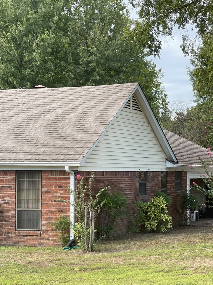 Memphis, TN - Picking up the final insurance check from our customer. We built a beautiful new pulley warranty roof for him and they are absolutely happy.