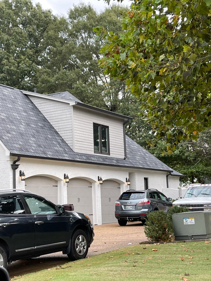 Collierville, TN - We are on our second day repairing a patio kitchen roof leak. We are installing a two ply rolled roofing system.