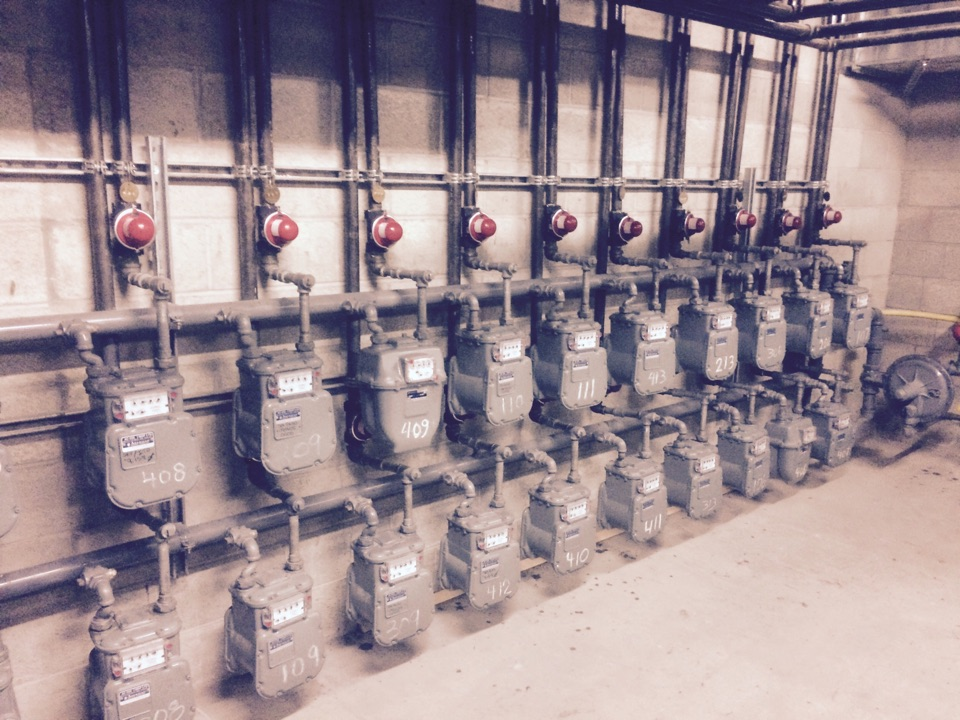 Los Angeles, CA - Installing earthquake valve on the gas meters
