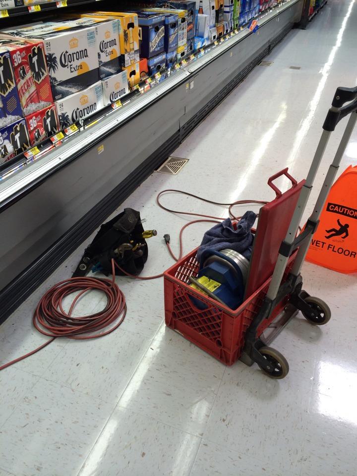 La Habra, CA - Drain cleaning beer cooler lines at Walmart superstore.