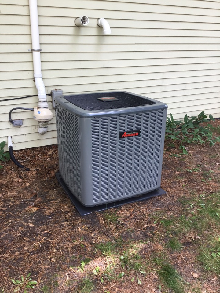 Bloomington, IL - Seasonal maintenance on this 16 SEER Amana AC installed by Lartz Heating and Air.