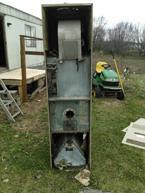 Downs, IL - INSTALLING NEW FURNACE. REMOVED AN OLD 1980`s COLEMAN 80% TRAILER FURNACE.