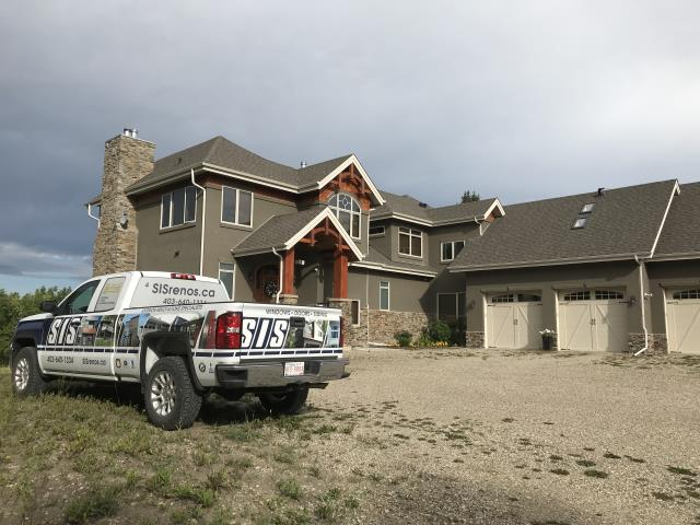 Rocky View County, AB - Out north of Cochrane checking out a stucco renovation on this lovely country home.