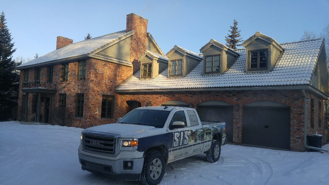 Calgary, AB - Out at Elbow River Estates checking out a completed project with James Hardie Lap Siding and Trim. Looks amazing!