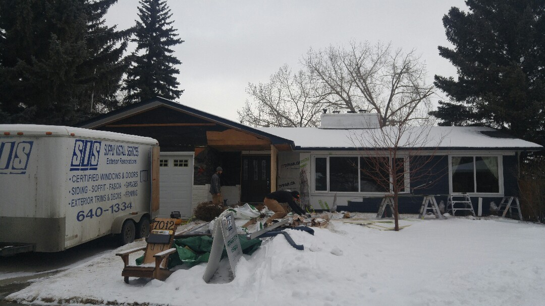 Calgary, AB - Elbow Drive New project James Hardie Deep ocean and trim, nice!