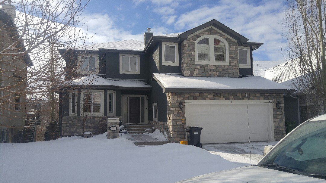 Calgary, AB - SIS completed all the James Hardie NT3 trim around windows and painted the entire house.  Looks very sharp!