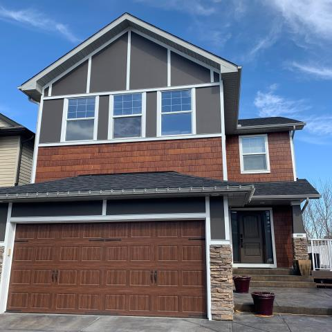 """Calgary, AB - Finished! Rich Espresso Hardie Panel, smooth Arctic White Hardie Trim and custom stained Staight Hardie Shake Accents!! Finally a """"SWEET"""" Coastal Grey Fibreglass Front Entry Door"""