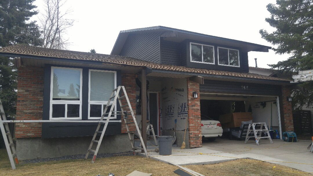 """Calgary, AB - Woodbine Another great vinyl project with James Hardie Panel NT3 11.25"""" trim on the front windows!"""