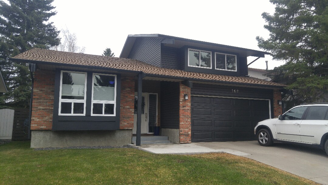 Calgary, AB - Another one completed! Vinyl siding James Hardie NT3 trim around the windows James Hardie Panel under windows Lux panel front entrance Very nice!