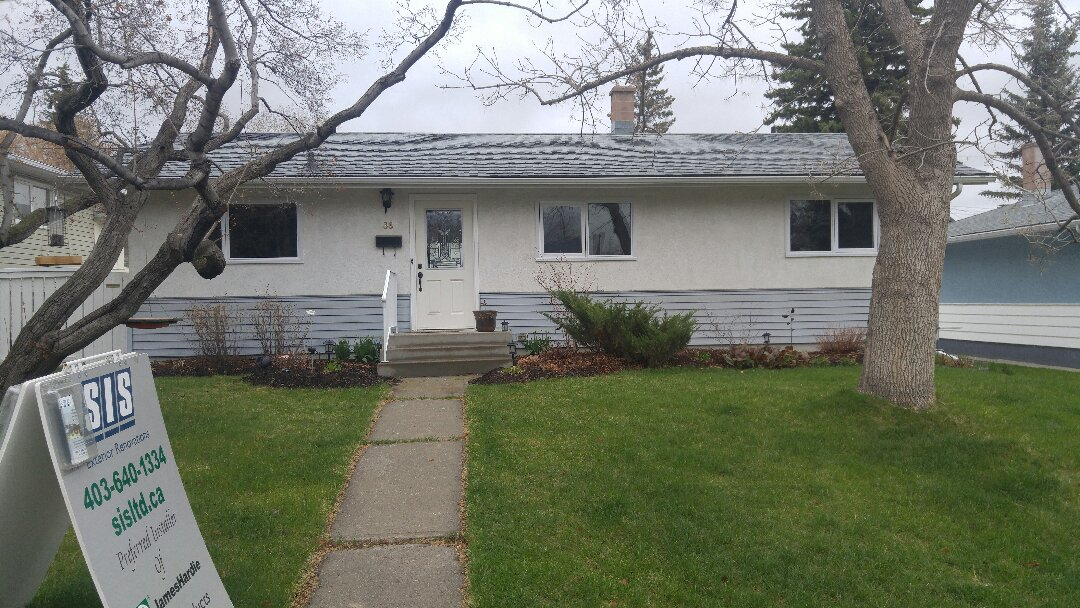 """Calgary, AB - The """"before"""" photo as this home prepares to be transformed to.... James Hardie lap siding Night Grey with James Hardie NT3 Corner trim Night Gray. The stucco will be painted AF 700 Storm. Can't wait to send """"after"""" photos! Stay tuned"""