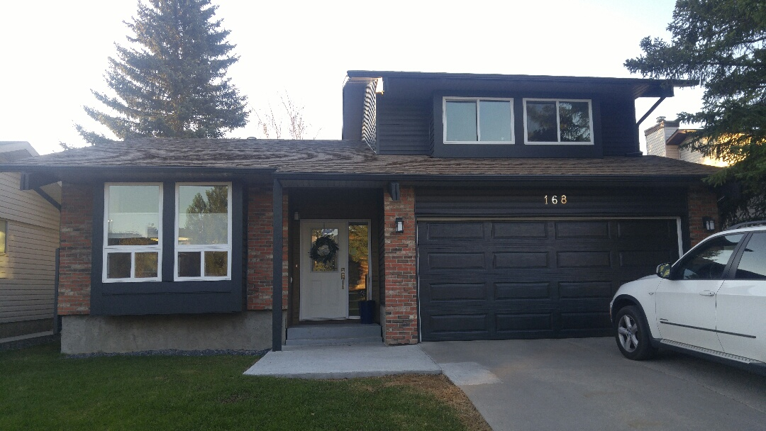 Calgary, AB - Finished Lux panel front area James Hardie NT3 Trim and James Hardie panel around the windows. Vinyl siding Ironstone to finish the home  Well done