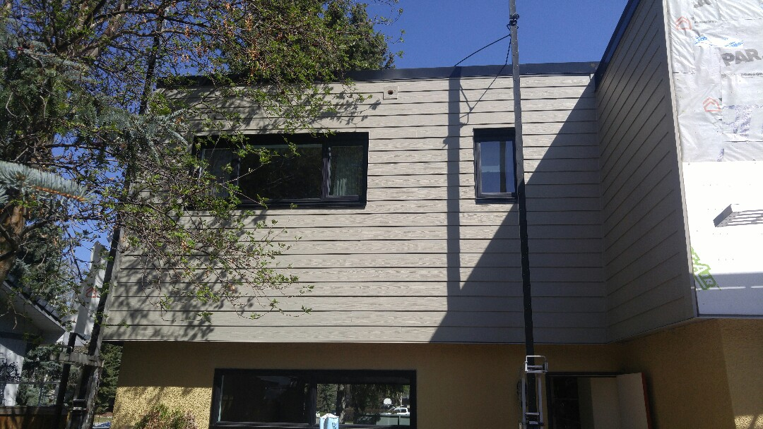 "Calgary, AB - Current project. James Hardie lap siding Monterey Taupe James Hardie NT3 5 5"" corner trims The next wall picture to follow!"