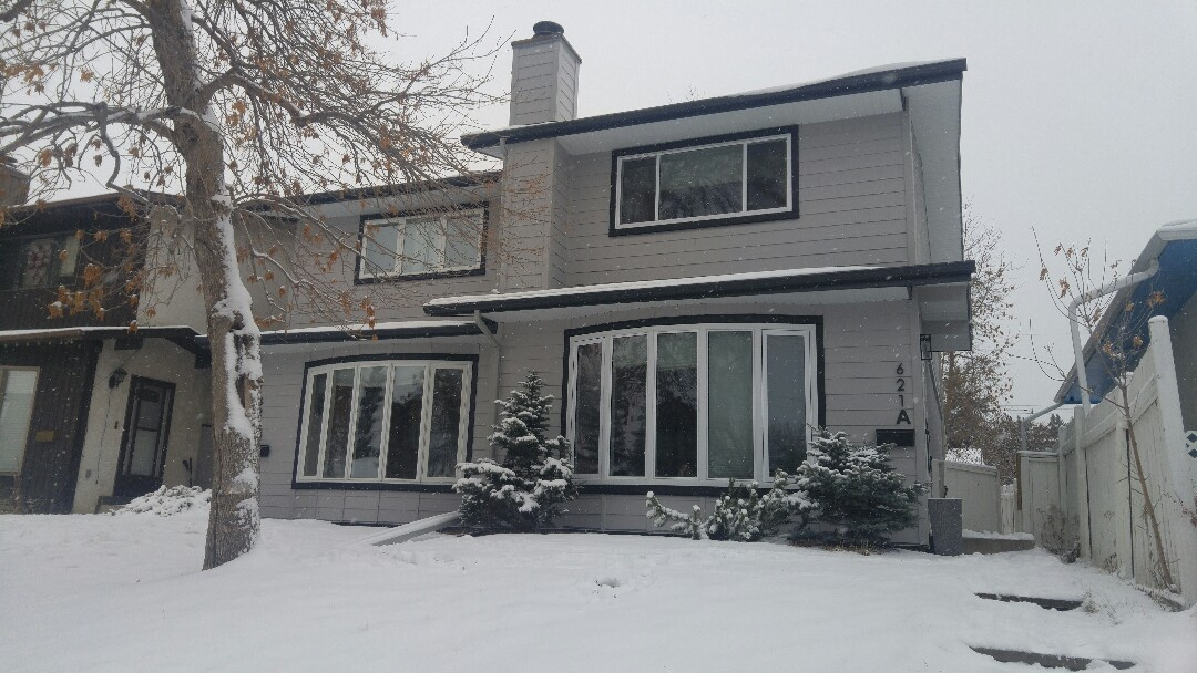Calgary, AB - Another project completed! South West Calgary James Hardie lap siding Pearl Gray with matching James Hardie Smooth NT3 trim  Well done!