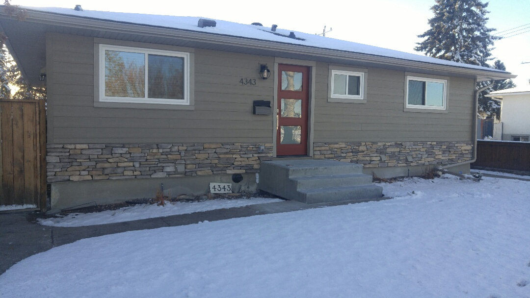 Calgary, AB - Stone all done James Hardie siding James Hardie NT3 trim