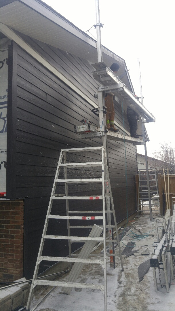 Calgary, AB - Woodbine Hardie Plank Blackwater Hardie board siding Smooth James Hardie Trim Looking good